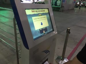 Taxi queue ticket dispensing machine at Suvarnabhumi International Airport